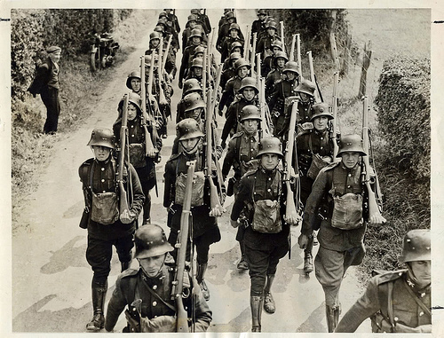 The IRish Army in 1930s German style helmets. Troops were called out to aid the Gardai in Limerick in 1935.