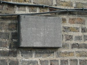 a granite plaque on the wall of the Fransiscan's Foreign Mission Office in Dublin marking the site of a hall where The Hibernian Rifles, Na Fianna Éireann and other republican groups used to hold meetings.