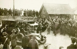 The Volunteers cheer as a car takes the newly imported rifles away from Howth pier.