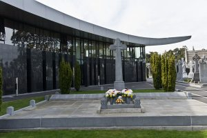 Michael Collins' grave at Glasnevin, the National Army memorial is inscribed on the low wall around the main grave.