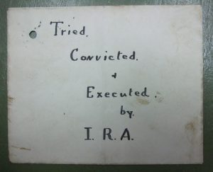 An IRA spy label attached to the body of Patrick Larmour.